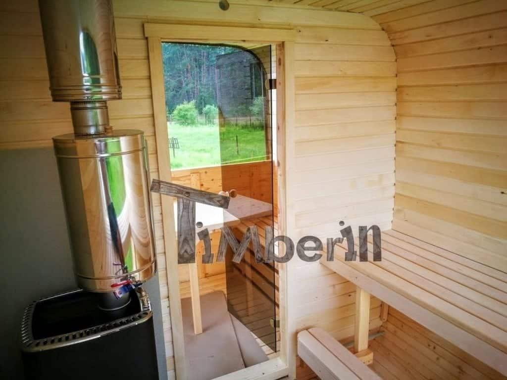 quadratische aussensauna mit harvia holzofen und vorraum timberin. Black Bedroom Furniture Sets. Home Design Ideas