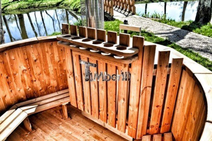 Badetonne-Badezuber-Badebottich-Badefass-mit-Holzofen-700x466 Badezuber - Badefass - Badetonne - Badebottich - Hot Tubes für Ihren Garten!