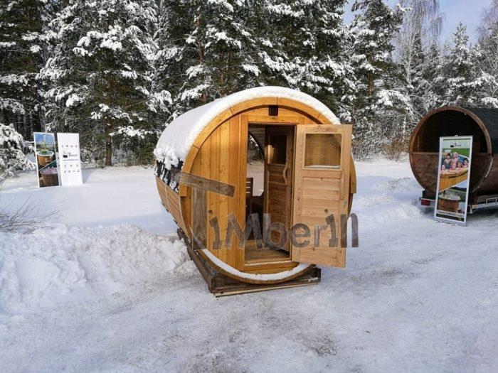 Saunafass-4m-mit-vollem-Panoramafenster-Vorraum-und-Holzofen-700x525 Fasssauna - Saunafass - Aussensauna mit Vorraum, Holzofen in der Schweiz kaufen
